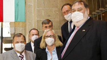 Masked delegation... (clockwise from front left) parliamentarians Bob Baldwin,  John Murphy,  John Hogg, Barry Haase,  Dick Adams, and Belinda Neal.