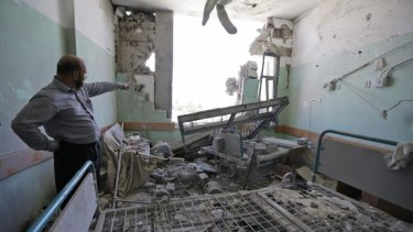 Afif Quneibi, a Palestinian orthopaedic specialist, inspects the damage to a patient room at the al-Aqsa Martyrs hospital, caused by Israeli strikes on July 21, in Deir al-Balah.