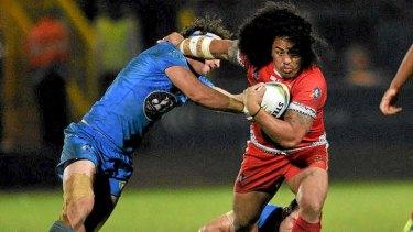 Hard running: Fuifui Moimoi of Tonga breaks through a tackle.