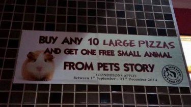 The promotional sign which has since been removed by Pizza Hut.