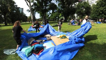 Occupy Melbourne protesters pack up gear in Treasury Gardens.