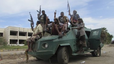 Militiamen loyal to President Abd-Rabbu Mansour Hadi ride through Aden last week.