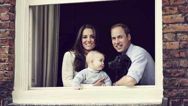 The Duke and Duchess of Cambridge with their son Prince George and dog Lupo photographed at Kensington Palace.