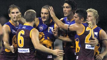 Brendan Fevola is congratulated by teammates after nailing his first AFL goal for the Brisbane Lions.