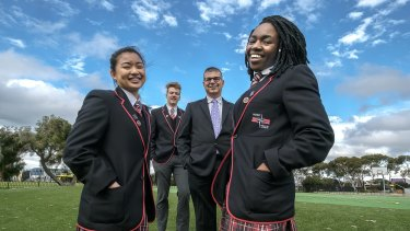 North Geelong Secondary College year 12 students  Mary Salazar, school captain Joel O'Keefe,  principal Nick Adamou and Irene Bakulikira.