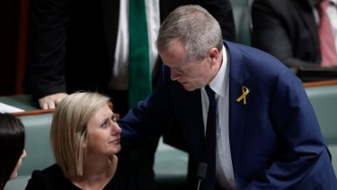 Lamb is comforted by Opposition Leader Bill Shorten.