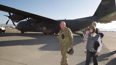 Prime Minister Julia Gillard and Chief of the Defence Force General David Hurley (left), disembark a C-130 aircraft at Kabul Airport after visiting the Multi-National Base in Tarin Kowt.