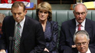 Winner ... Tony Abbott speaks in Parliament flanked by Malcolm Turnbull.