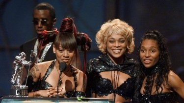 """Then there were three: (From left) TLC's Lisa """"Left Eye"""" Lopes with T-Boz and Chilli accepting an MTV award in 1999, with Sean Combs behind."""
