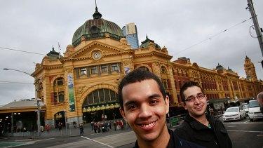 Melbourne University students Manuel Pineda (left) and Santiago Medina in front of the Flinders Street train station.