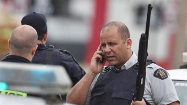 Police officers man a roadblock in Moncton, New Brunswick, Canada.