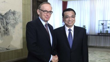 Pick your godfather ... Australian Foreign Minister Bob Carr shakes hands with Chinese Vice Premier Li Keqiang during a meeting in Beijing yesterday.