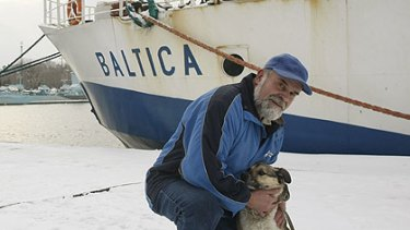 Adam Buczynski  with the dog found floating alone on an ice floe  off the Polish coast.