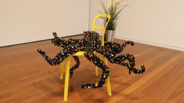 Eight arms and four legs: Claire Healy and Sean Cordeiro's Lego octopus on an IKEA chair.