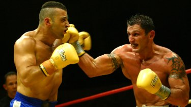 Wissam Fattal (left) in a kickboxing match in 2004.