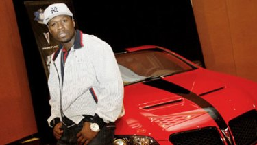Rapper 50 Cent and a Pontiac G8.