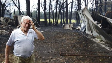 Morning after: Reg Hyde among the ruins of his building sheds in Salt Ash.