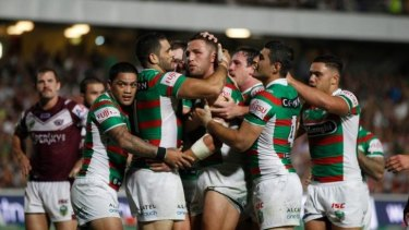 Happy Bunnies: Souths celebrate Sam Burgess' first-half try.