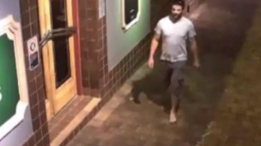CCTV footage of Morgan Huxley walking barefoot outside The Oaks in Neutral Bay at 1.32am on September, 8, 2013.