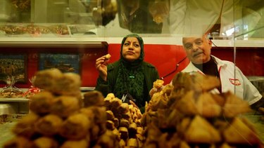 Dangerous diet … Hana Hajeh, a diabetic, shops for sugar-free sweets in preparation for Ramadan. She is served by Allen Sayed from Abu Adam Sweets in Lakemba.