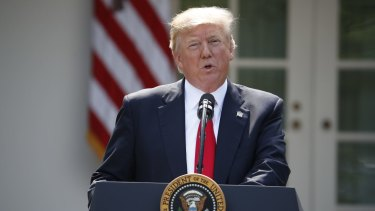 President Donald Trump announcing the US was withdrawing from the Paris deal.
