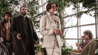 Tilda Swinton and Chris Evans in Bong Joon-Ho's <i>Snowpiercer</i>.