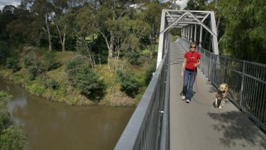 More than $250,000 has been allocated to Parks Victoria to begin building a bridge across the Yarra River in Abbotsford, at a spot where cyclists currently have to walk their bikes up or down steps.