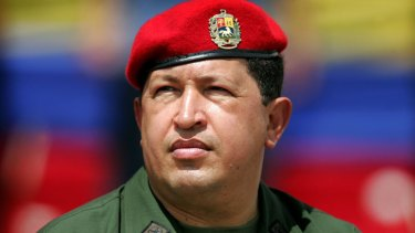 Venezuela's President Hugo Chavez wears an army uniform and the red beret of his parachute regiment while attending a military parade in Caracas in this April 13, 2005.