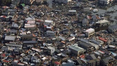 Collapsed houses and debris  in Kesennuma city, Miyagi prefecture, in the wake of the tsunami in Japan.