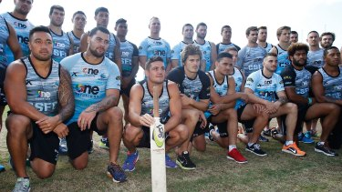Tribute: Sharks players honour the memory of Phillip Hughes on Saturday.