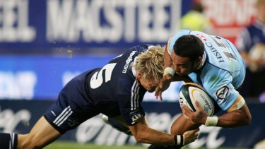 Sosene Anesi of Australia's Waratahs, right, is tackled by Joe Pietersen of South Africa's Stormers, left, during the Super 14 rugby match in Cape Town on Saturday, February 20, 2010.