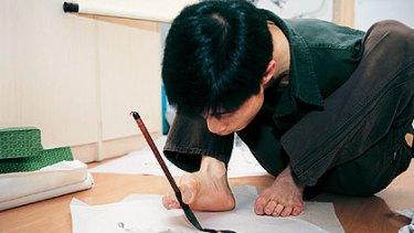 Huang Yangguang taught himself to write and draw.