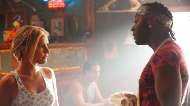 Anna Paquin as Sookie Stackhouse and Nelsan Ellis as Lafayette Reynolds in a scene from True Blood.