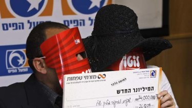 Winners ... the Israeli couple wore masks to protect their identities.