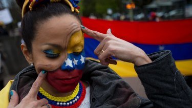 Human rights activists protest against the current situation in Venezuela outside the World Court, United Nations' highest judicial organ in The Hague, Netherlands in April.