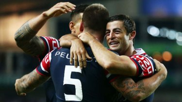 Anthony Minichiello of the Roosters celebrates a try against Wigan.