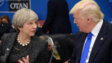 US President Donald Trump, right, speaks with British Prime Minister Theresa May.