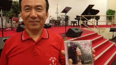 Pastor Joseph Hong holds a CD Dami recorded for the Brisbane Full Gospel Church in Eight Mile Plains.