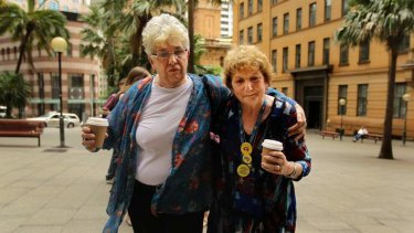 Eyvette Parr comforts survivor of abuse Trish Charter (right), who was at St Joseph's Orphanage in Goulburn, outside the Royal Commission.