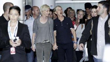 Ellen DeGeneres and Portia de Rossi arrive at Sydney Airport.