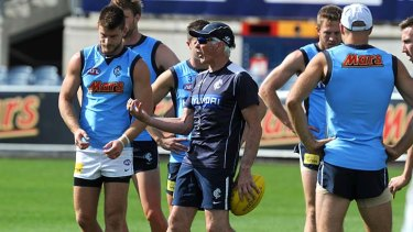 Mick Malthouse encourages his players to grab their opportunity against the Tigers.