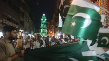 People buy flags to celebrate the Pakistan's Independence Day on Monday, in Peshawar, Pakistan.
