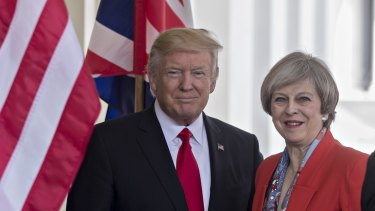 President Donald Trump with Prime Minister Theresa May on Friday.