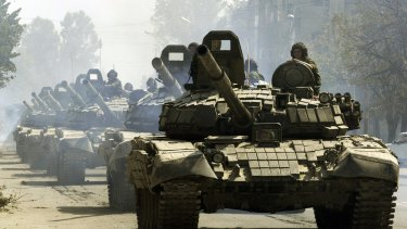 Russian tanks drive through Tskhinvali, the regional capital of Georgia's breakaway province of South Ossetia, moving to the Russian border in 2008.