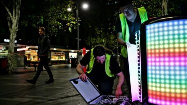 Sam Johnson (left) and Steven Bai (right) install their Tetrabin ahead of the launch of Vivid LIGHTS.