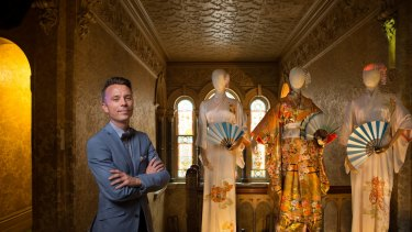 Drew Grove, state commercial manager of The National Trust of Australia, with some of The Dressmaker costumes at Rippon Lea House.