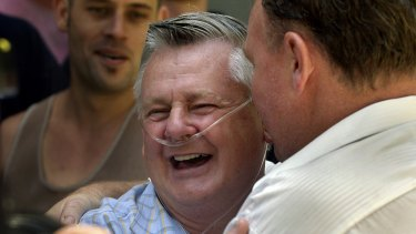 The late Bernie Banton, leading figure in the compensation fight against James Hardie, hugged by industry workers in December 2004.