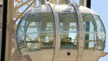 """A couple gets amorous in one of the Southern Star's glass carriages last week. """"I suppose it had to happen,"""" said the observation wheel's chairman, Fred Maybury."""