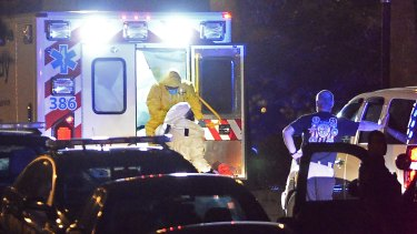 An ambulance carrying Amber Vinson, the second health care worker to be diagnosed with Ebola in Texas, arrives at Emory University Hospital on Wednesday.