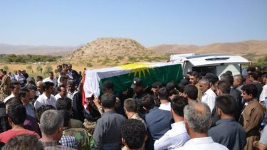 Casualty of war: Mourners carry the coffin of a Kurdish fighter in Iraq's Sulaimaniya province.